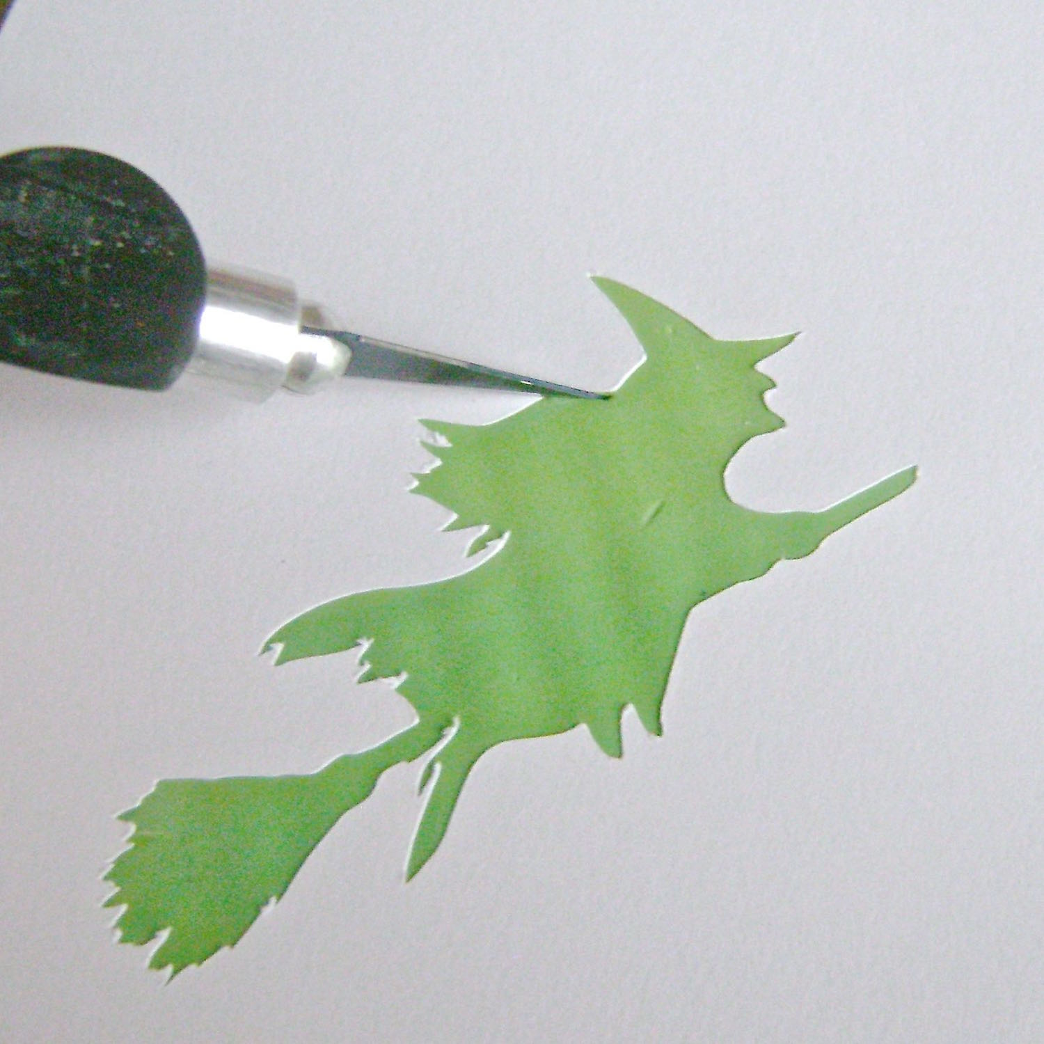 step 12 - Use a craft knife to cut the image out of the clay.