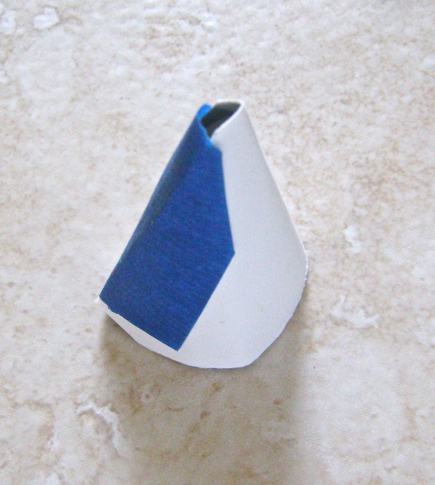step 5 - Match up the long straight edges of the cone template and tape them together.