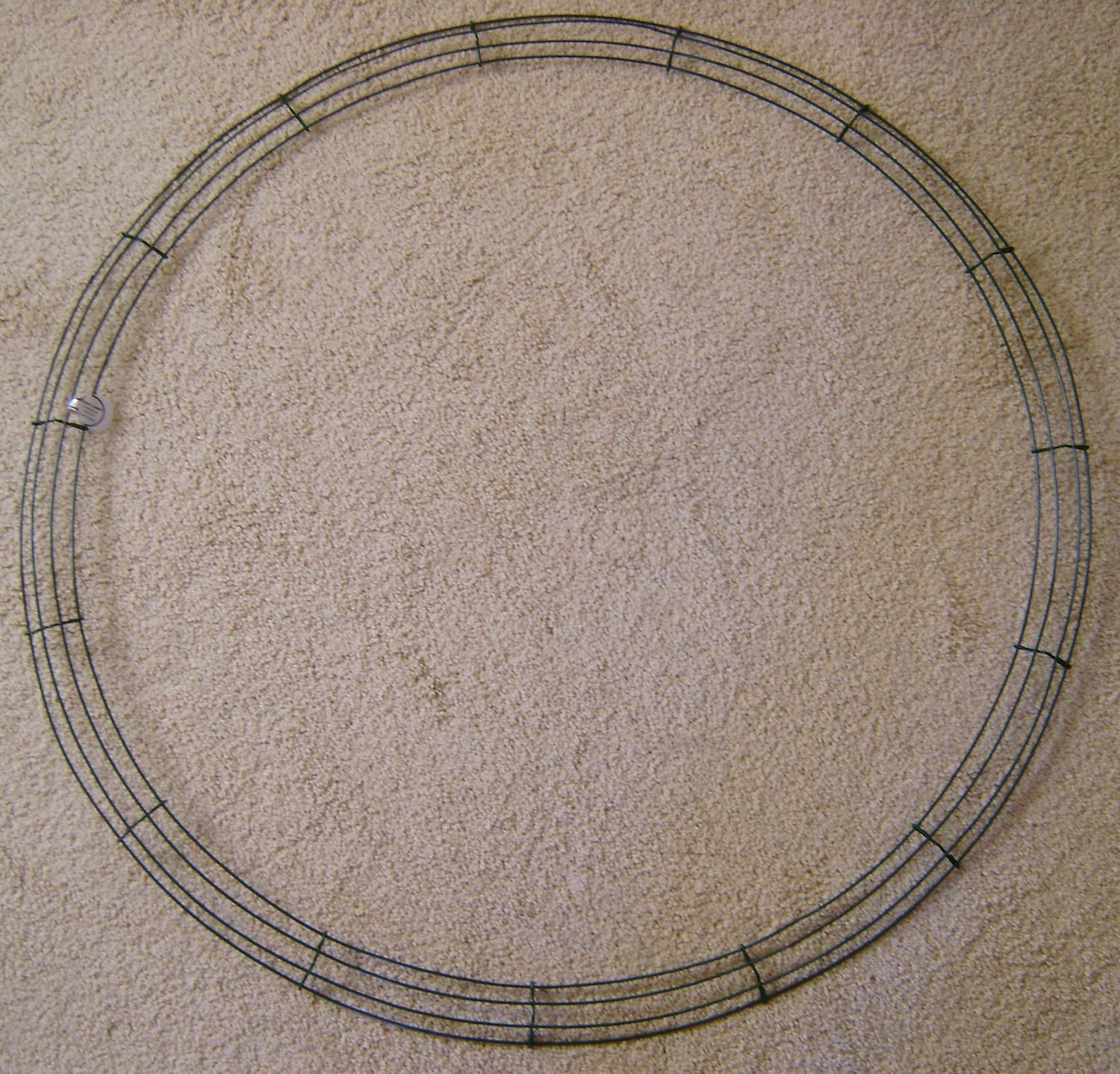 "The skinny 36"" wreath is made with four circular wires."