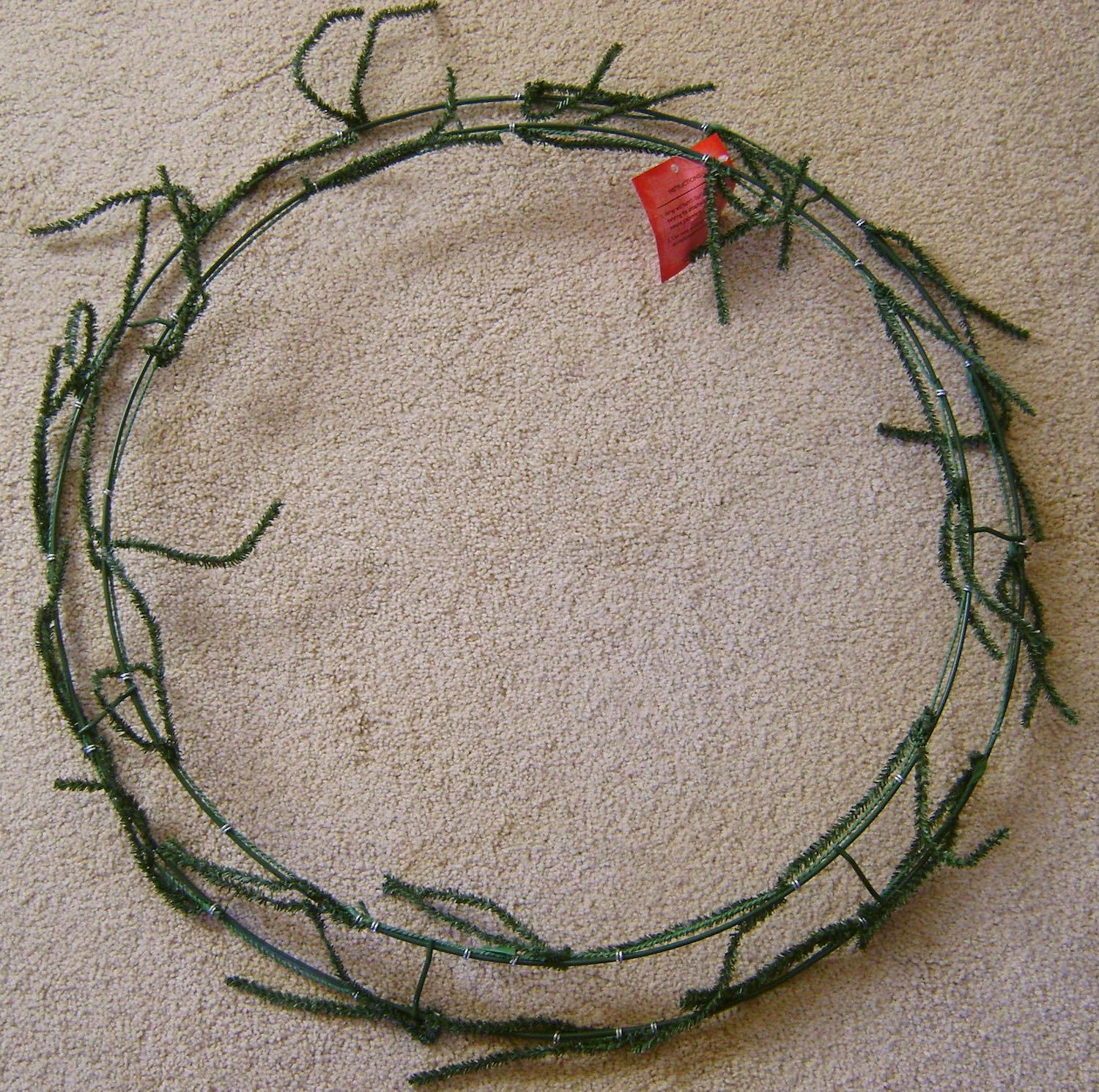 "The 24"" wreath is made with two circular wires and includes twist ties for attaching decorations."