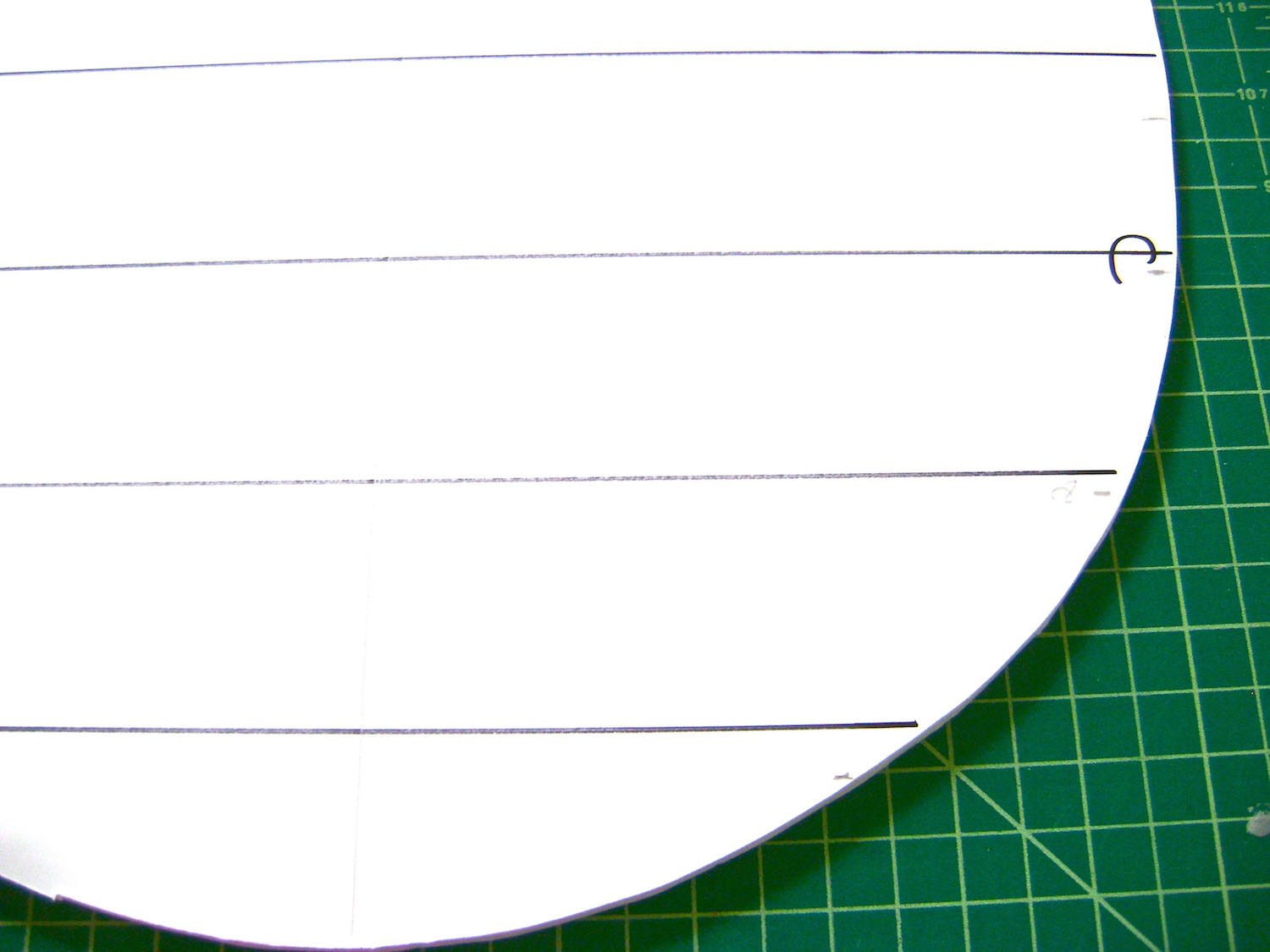 """step 2 - With a pencil, draw horizontal lines across the egg 1.50"""" from the top and bottom. Between them, draw lines every two inches."""