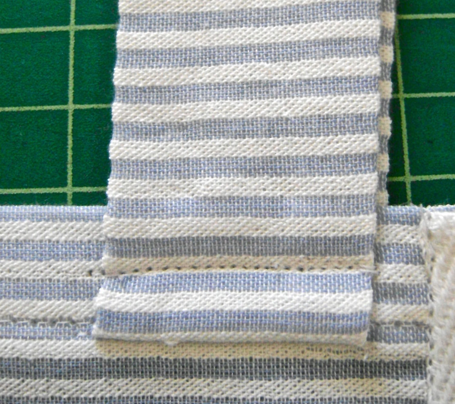 """step 16 - Turn the straps up and topstitch 3/8"""" from the first row of stitching."""