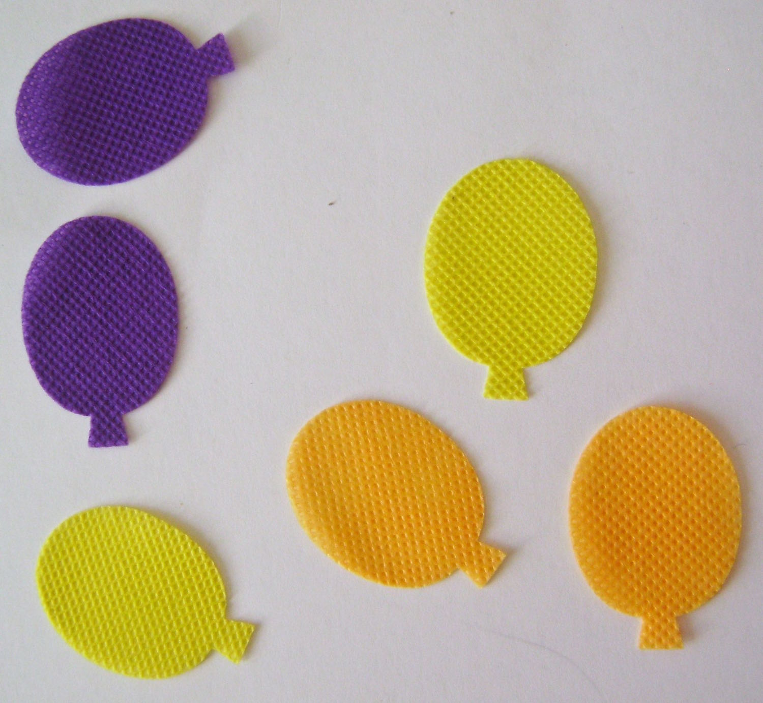 "step 8 - Cut six pairs of balloon shapes in a variety of fabric colors to measure about 1.25"".  Apply Turbo Tacky Glue to the perimeter of the balloons and put the matching color on top.  Leave the center bottoms open 1/4""."