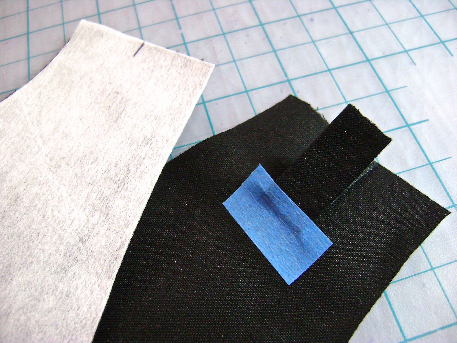 "step 5 - Fold each of the four pieces in half and align them with the center of the purse yoke extensions. Pin or tape in place. Stitch through all thicknesses 1/2"" from raw edges."