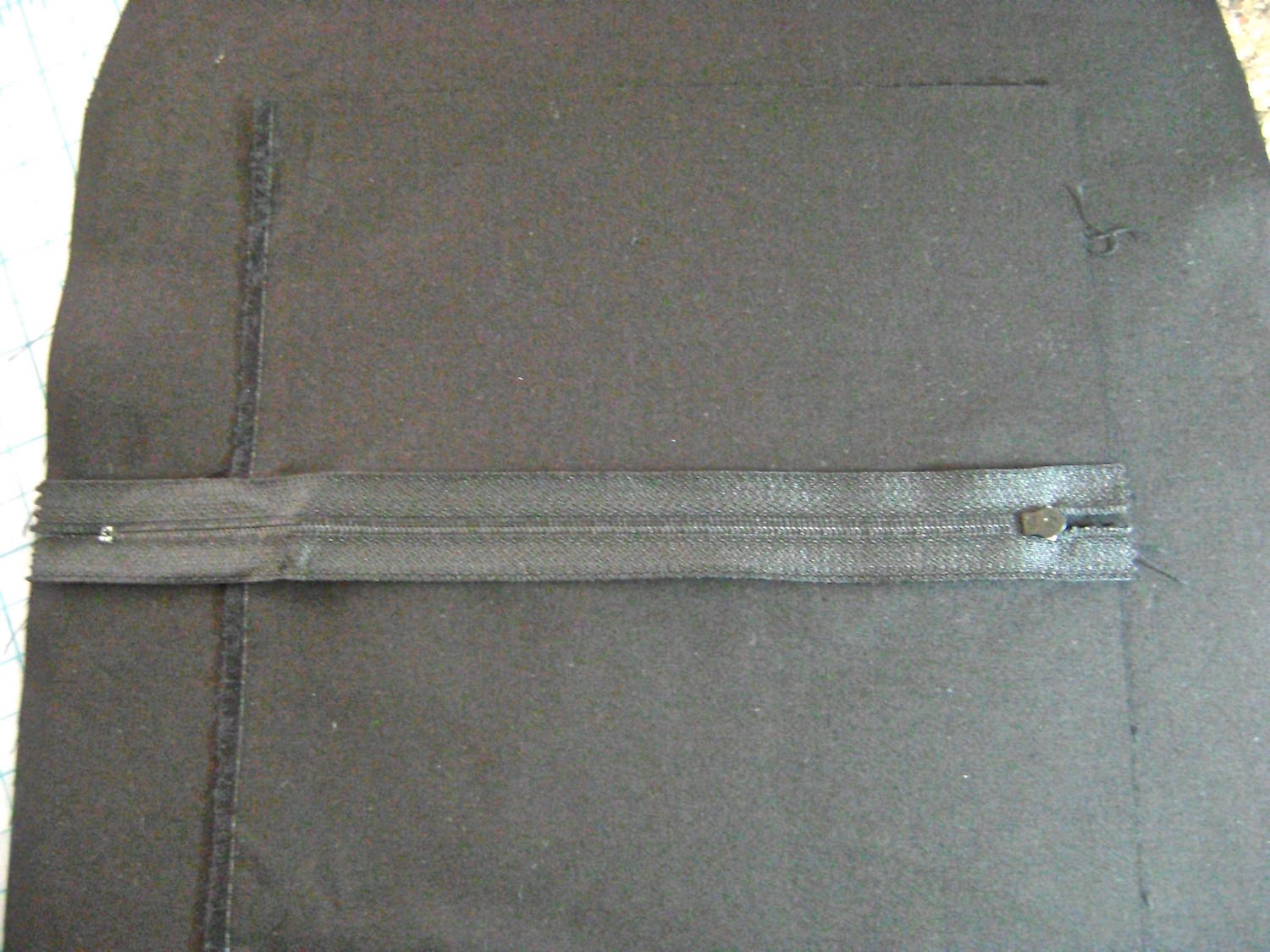 step 6 - Turn over and center zipper right side down.