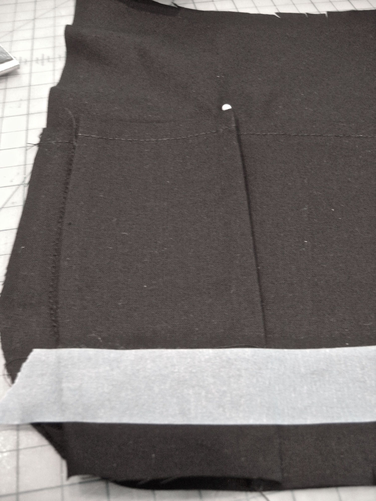 step 6 - Remove the item and lightly press, pleating the excess fabric on both pocket edges.