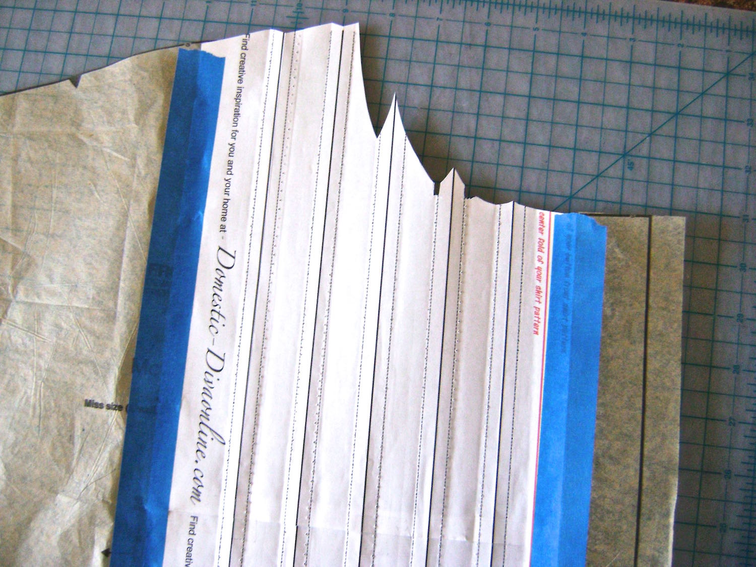 step 8 - Remove all the stitching lines in the template page.  It's easiest to do this if you cut the top and bottom thread of each thread line every six inches or so, instead of trying to pull out the treads in one long piece. Iron the template page so it lays flat.  Join the previously sliced narrow piece of your pattern flush (no overlap) to the template at the center line.  Your pattern piece is complete and you are ready to cut out your shirt front.