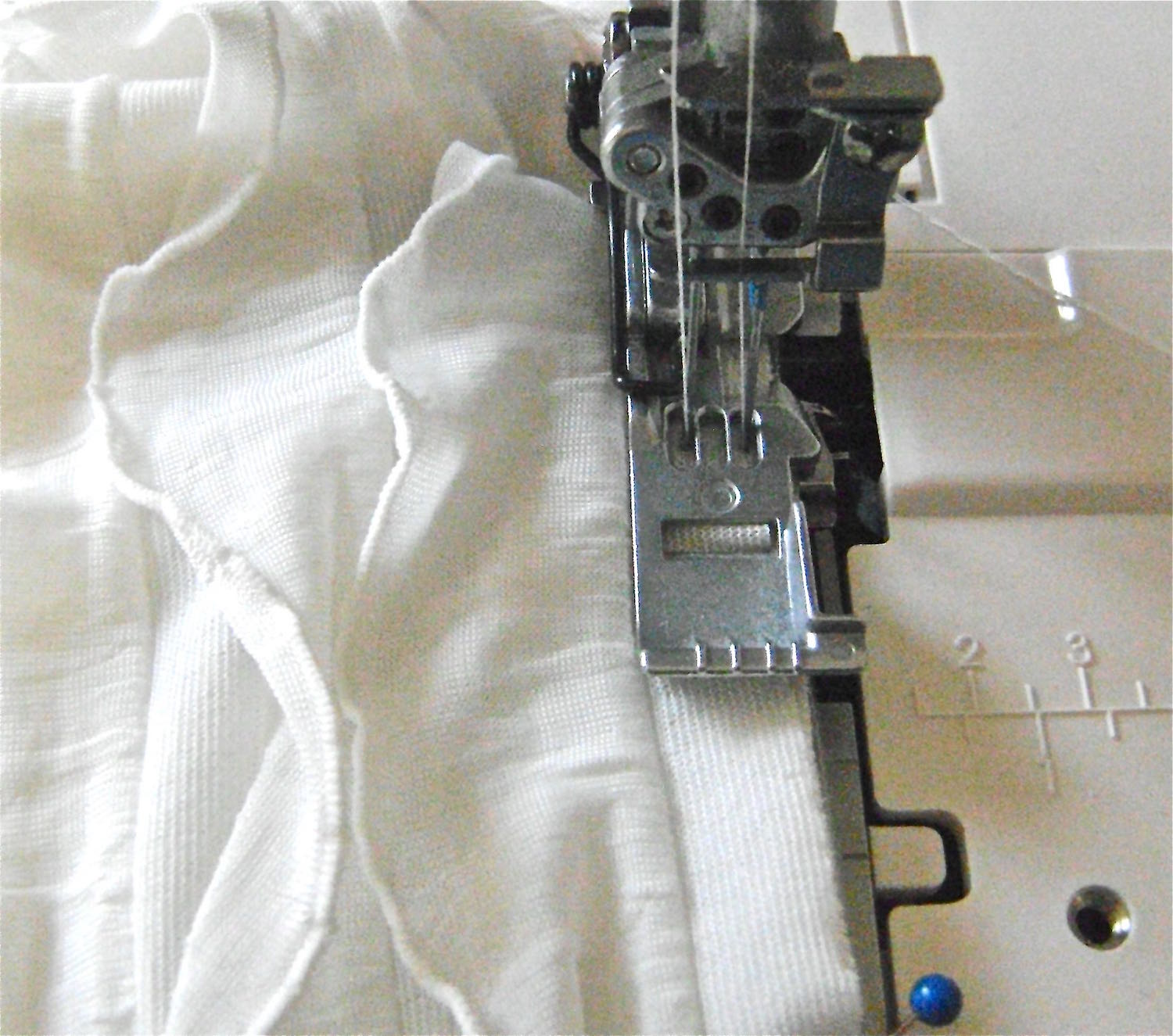 """step 6 - Stitching ½"""" from the raw edge, sew through the ruffle margin, shirt fabric, and stay tape, beginning at the shoulder and ending at the slit in the """"V"""". Finish the 3 joined edges with a zigzag or overlock stitch."""