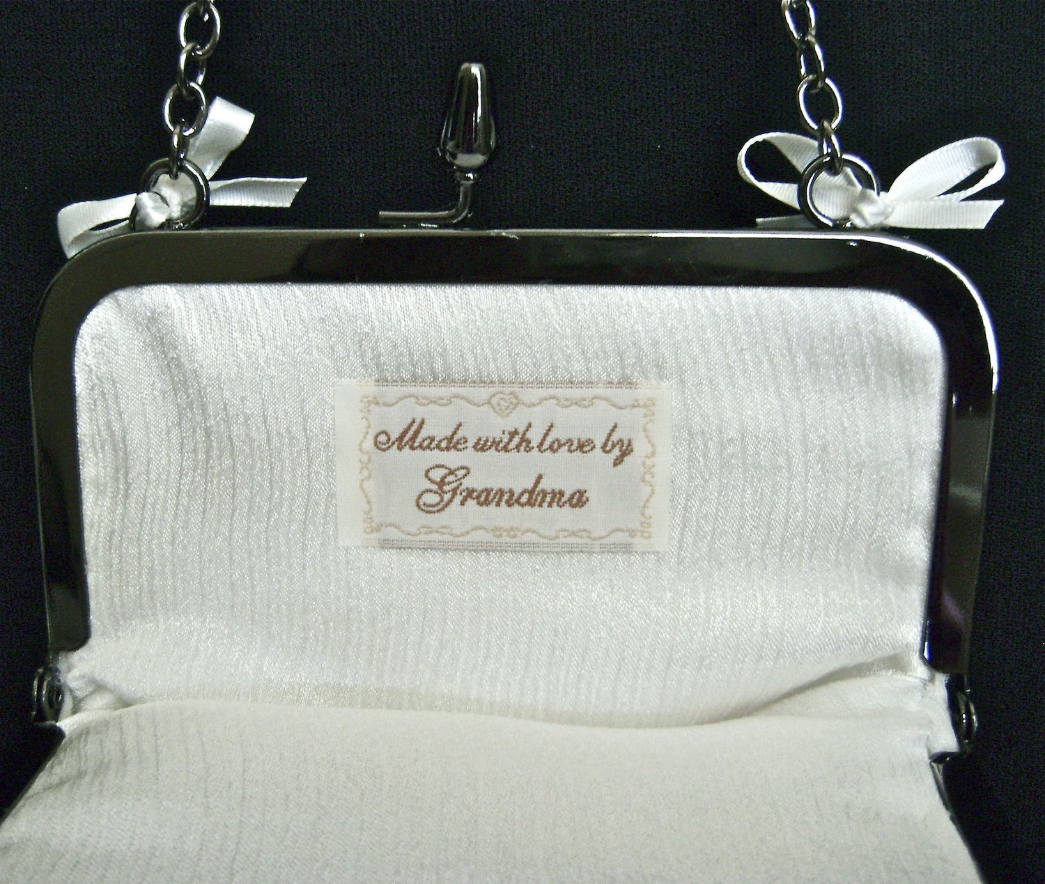 "Optional label inside - Attach it by sewing or fabric glue.  Finished purse measures 7"" x 7""."
