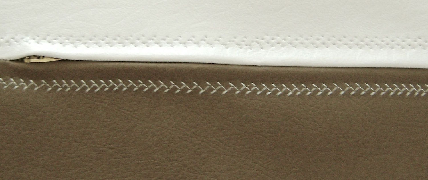 step 6 - Using a feather stitch, top stitch the zipper to the vinyl across the white piece then the Chestnut piece on both the front and back bag sections.