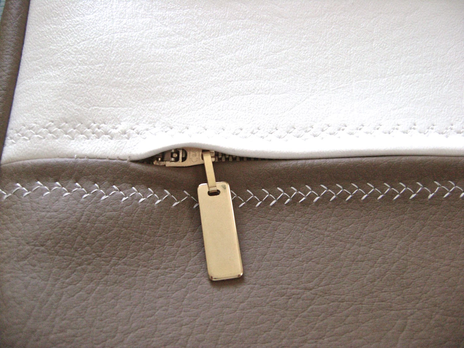 step 23 - Attach decorative zipper pulls to the front and back zippers for easy access.
