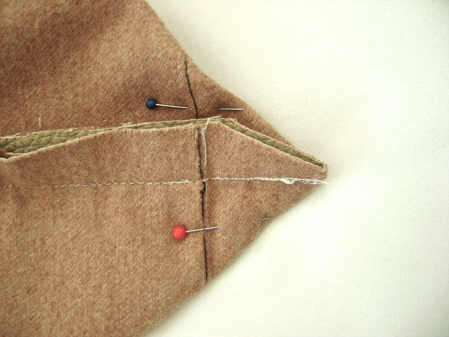 """step 13 - Spread out the bottom corners to form a point with 1.50"""" on each side of the seam line. Use a marker to define the line which should be 3"""" long. Sew across the line, and again to reinforce it."""