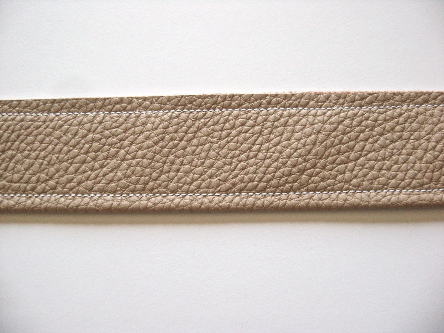 """step 17 - Fold each strap in half vertically with wrong sides together. Topstitch .25"""" from each long edge."""