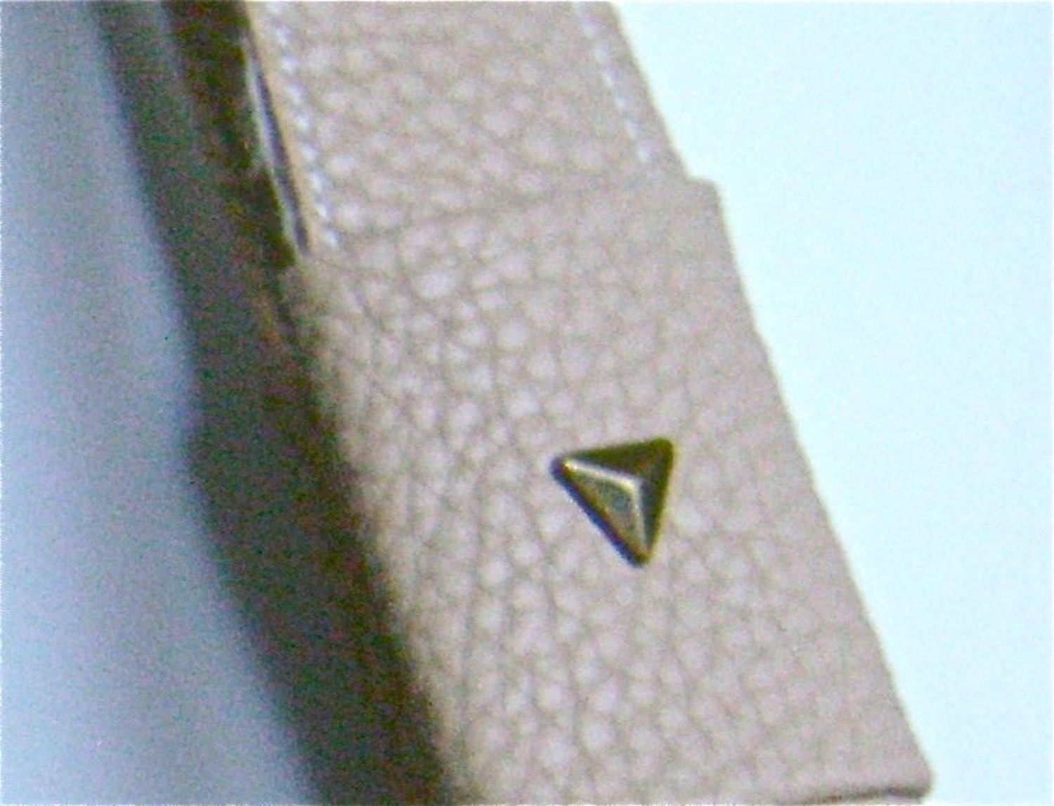 step 26 - Add metal stud triangles to the outer layer of the covers.