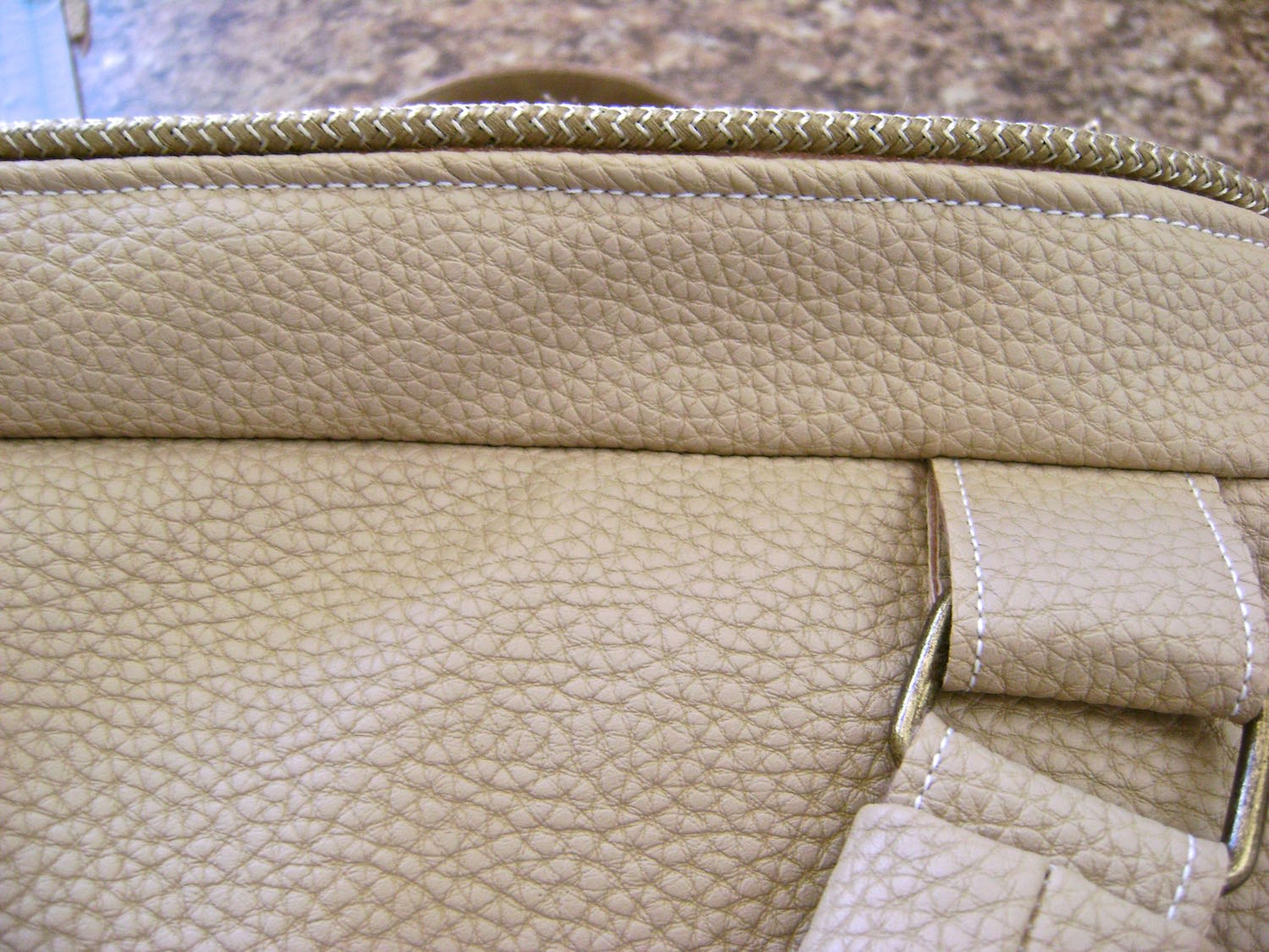 step 30 - With the four tabs in place, sew the raw edges of one band and fleece around the top of the bag.