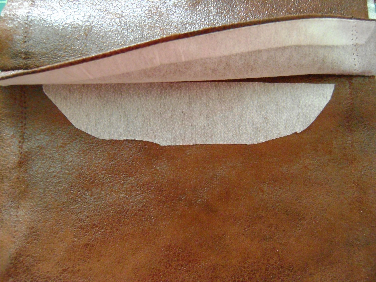 step 4 - Baste the straight edge of the feather cover to the edge of the front matching notches, with wrong side of cover against right side of fabric.  Cut out a piece of interfacing that will fit under the cover.