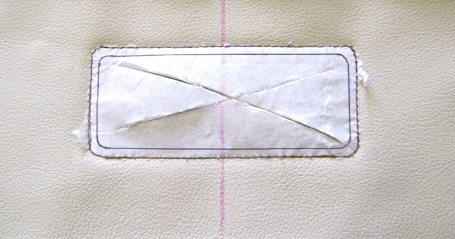 step 9 - Using copper colored thread, sew the stitching line through the tissue pattern.  Slash through the center with a craft knife and cut with scissors on the cutting line.  Pull away the tissue.  If bits remain an old toothbrush or pressing on them with scotch tape will easily dislodge them.