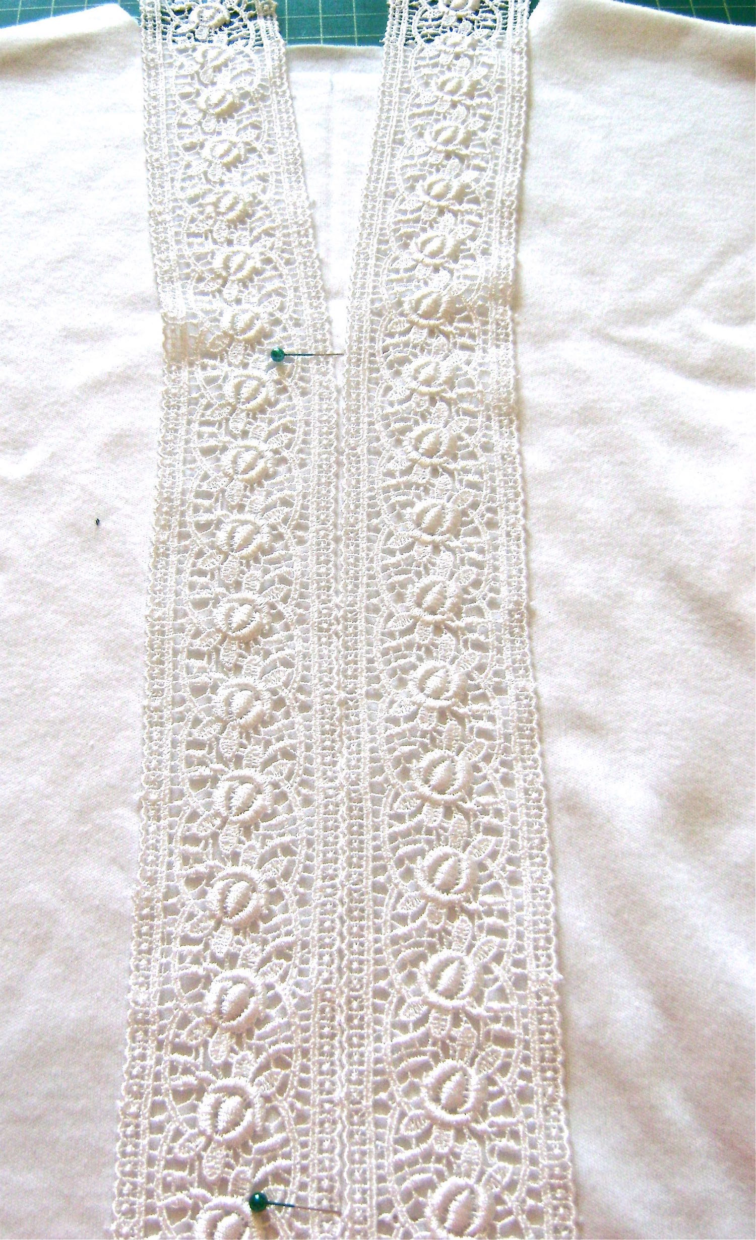 step 4 - Temporarily place two pieces of lace side by side down the front of the shirt with the long lace edges meeting on the crease.