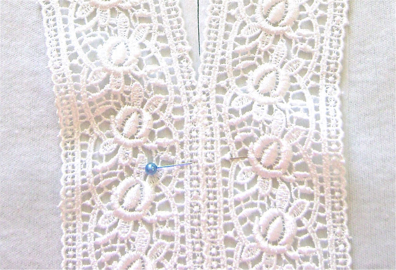 step 12 - Because the lace strips curve outward at the neck area, the outside edges will not lay smooth.  Remedy this by sewing a gathering stitch on the outside edges of the lace to ease in the extra fullness.