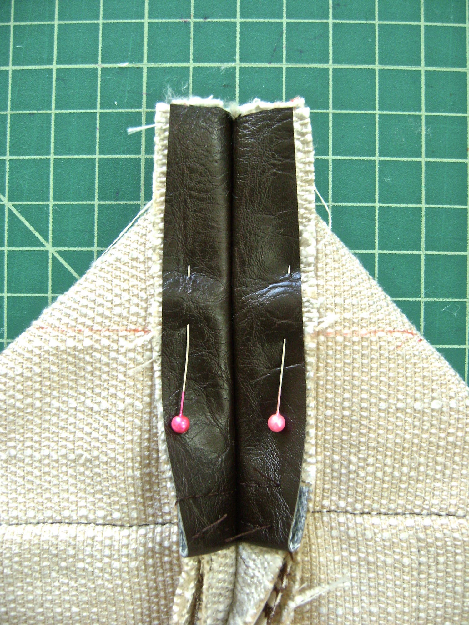 "step 5 -  Outer Shell Construction   Outer Shell Construction Starting at the bottom, sew up the side seams with the right sides together.  Reinforce the stitching across stress areas like the tops of pockets.  Flatten the bottom corner of the bag and create a triangle .  Draw a line across the triangle at 4"" with a marker.  Use a ruler to be sure the side seam is centered 2"" from each edge.  Sew across the line which will result in the 4"" bag bottom."