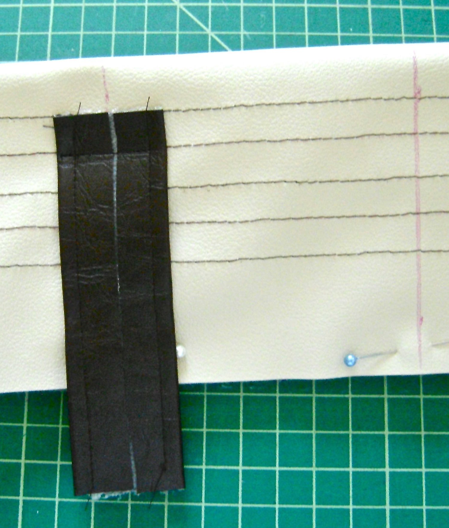 "step 11 - Position each tab 4"" from the center of the band.  Sew the right side of a tab to the right side of the top band with the edge of the tab aligning with the first line of stitching.  Sew over the second stitch line.  Trim the tab close to the stitching."