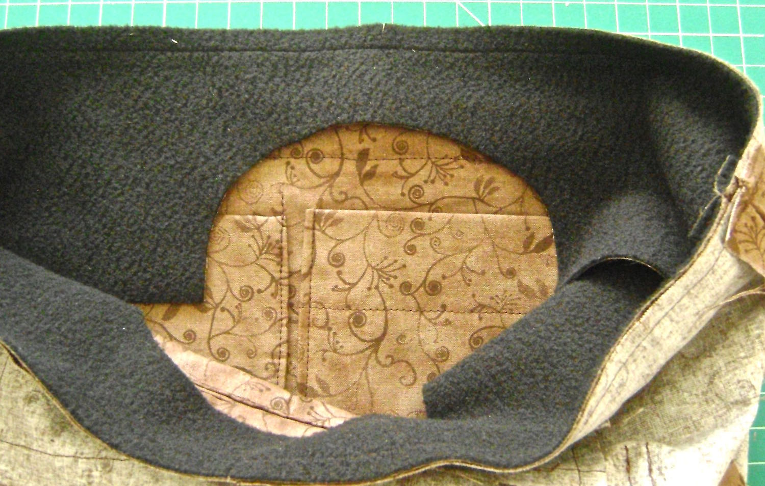 """step 23 - Sew the top facing with a 5/8"""" side seam and right sides together. Match the side seams of the facing to the side seams of the lining. Pin and sew the bottom edge of the facing with the top edge of the lining, right sides together."""