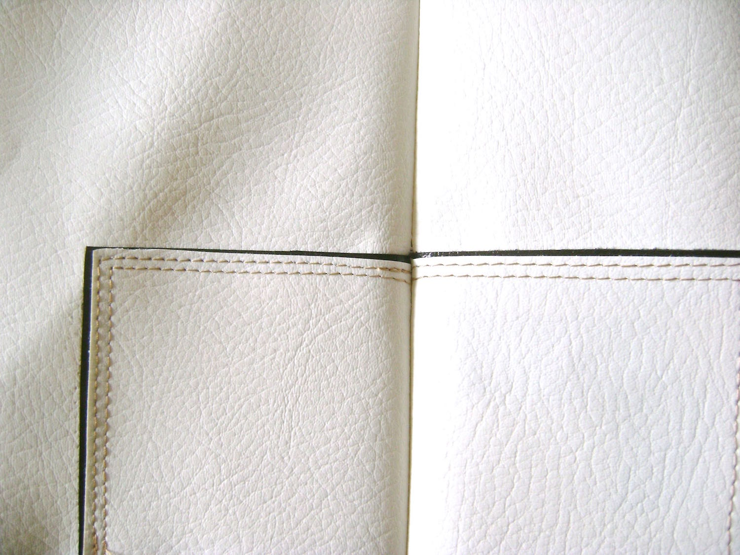step 5 -  Front and Back  Align the right side of the front and back purse pieces with the black bias tape matching. Secure the pieces with Wonder Clips.  They hold tight and will keep the pieces from shifting.  Sew together the purse side seams.  Press them open.  They will not lay completely flat but pressing them open will relax the seam.