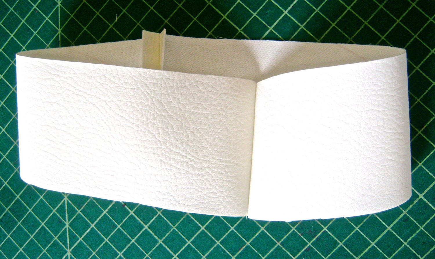step 7 -  Facing  Apply fusible interfacing to purse facings.  Sew facings with right sides together. Press the seams open.