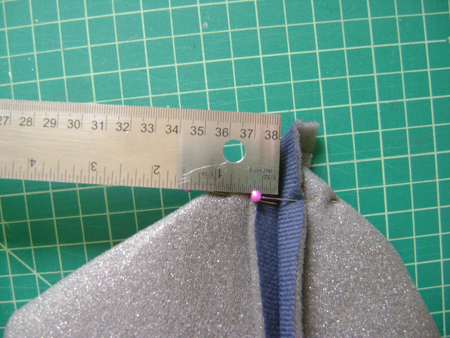 "step 8 -  Headliner  Sew the side and bottom seams of the headliner.  Fold the corner flat matching the side and bottom seams.  Pin the pieces together with 1"" to the left and right of the center seam.  Draw a straight line and stitch across it.  Trim away the excess."