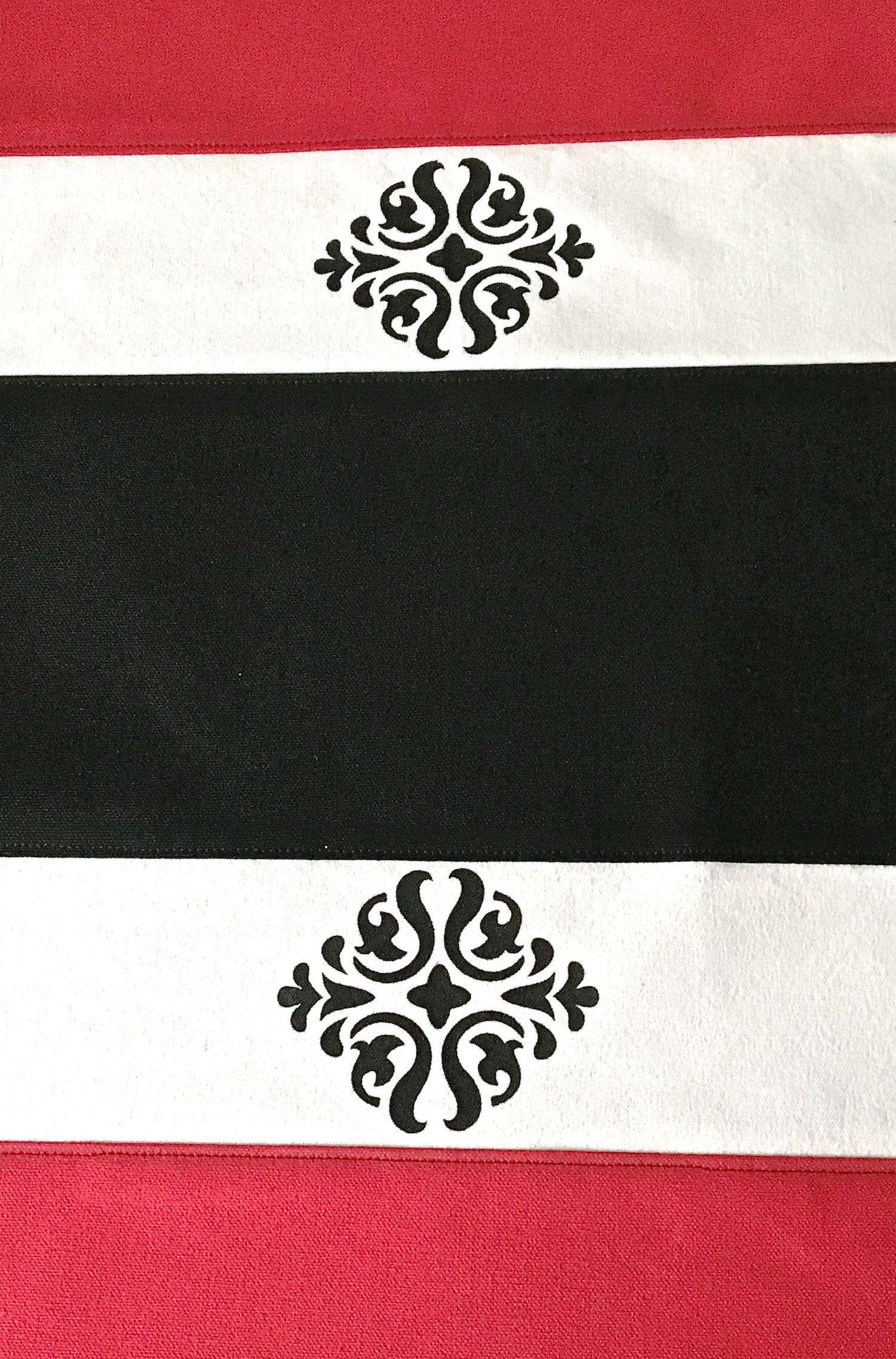step 5 - Sew white panels to each edge of the black panel.