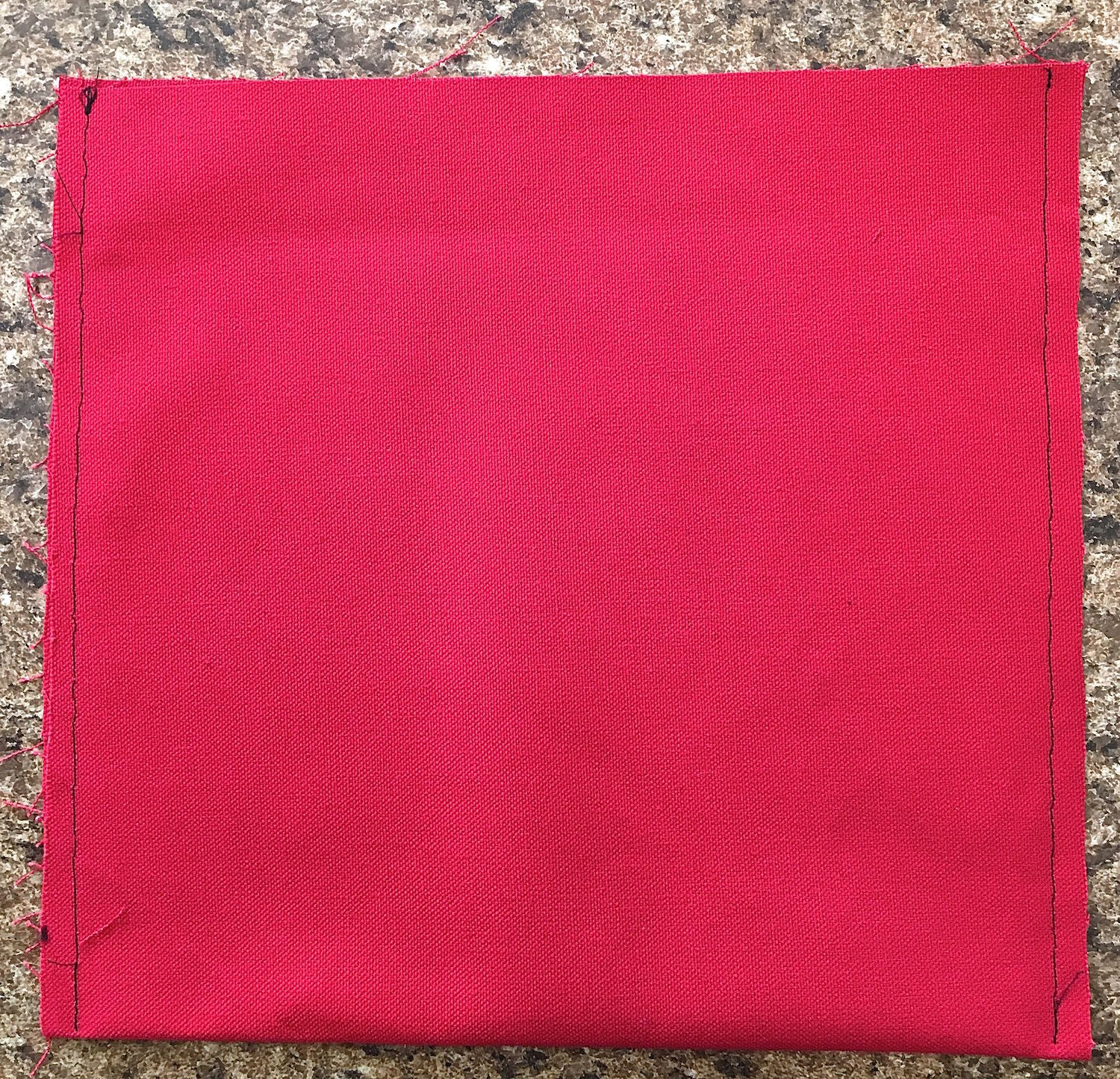 """step 12 -  Pocket  With the fabric right sides facing each other, fold the pocket piece in half to measure 10"""" x 10"""". Stitch the sides with .25"""" seams. Turn the fabric right side out and press the seams."""