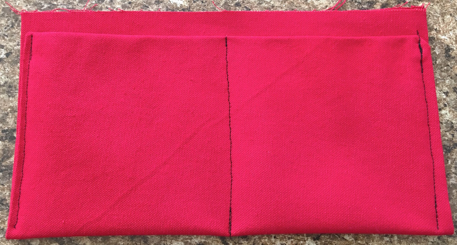 step 14 - Top stitch the sides through all thicknesses close to the edge. Sew a row of stitching up the center to create two pocket spaces