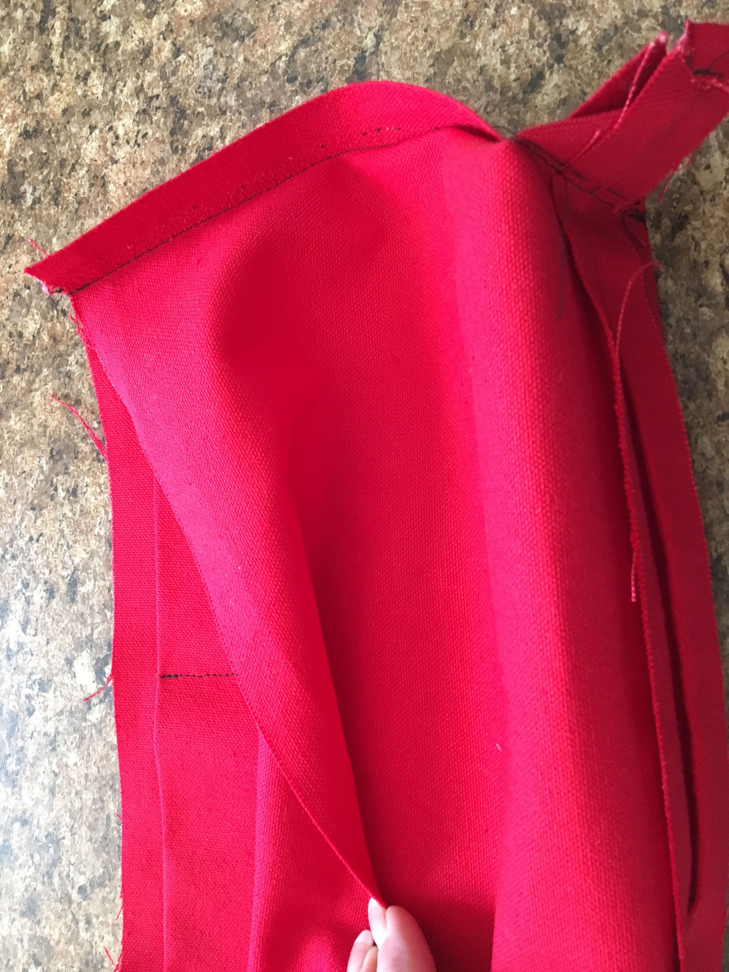 """step 15 - Center the pocket inside the lining and sew the pocket to the lining with a 1/8"""" seam. Pin the right side of the top lining edge to the right top outer edge of the bag. Sew together."""