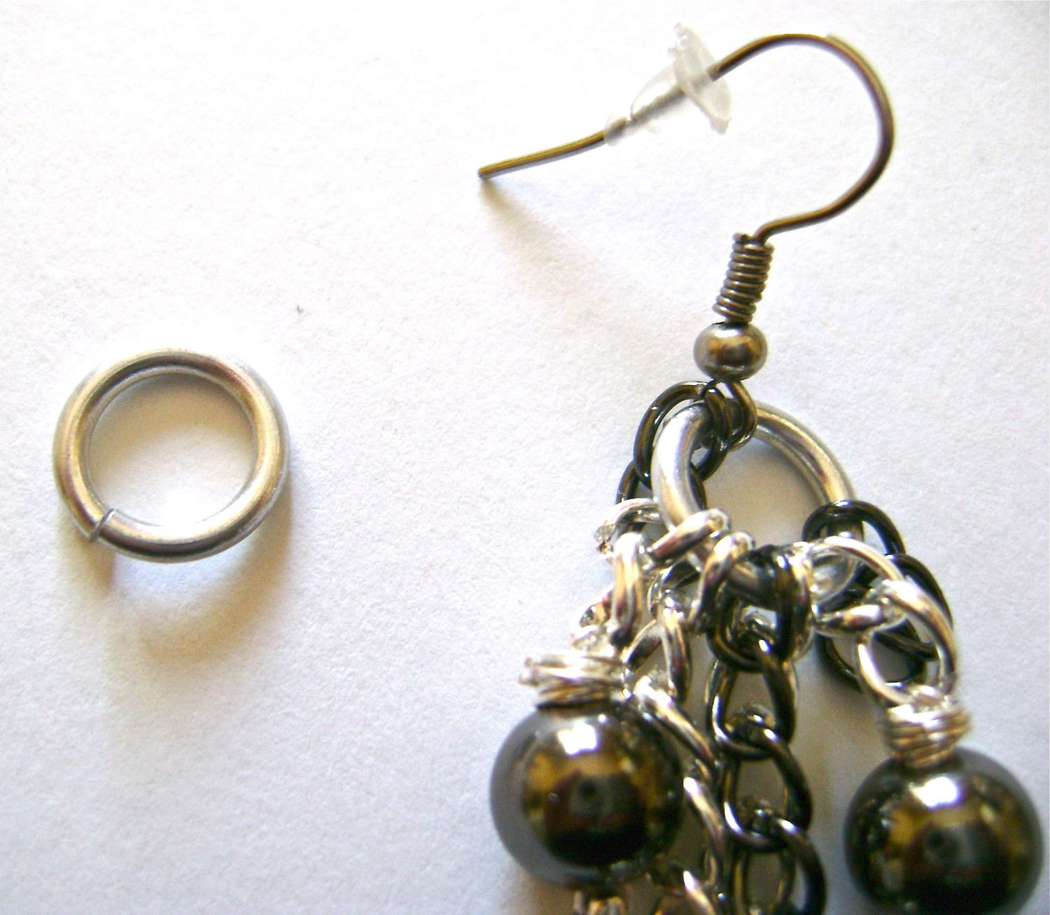 step 9 - To complete, attach the seven chain sections (see photo in step 8) in order onto a large jump ring followed by a purchased earring wire.