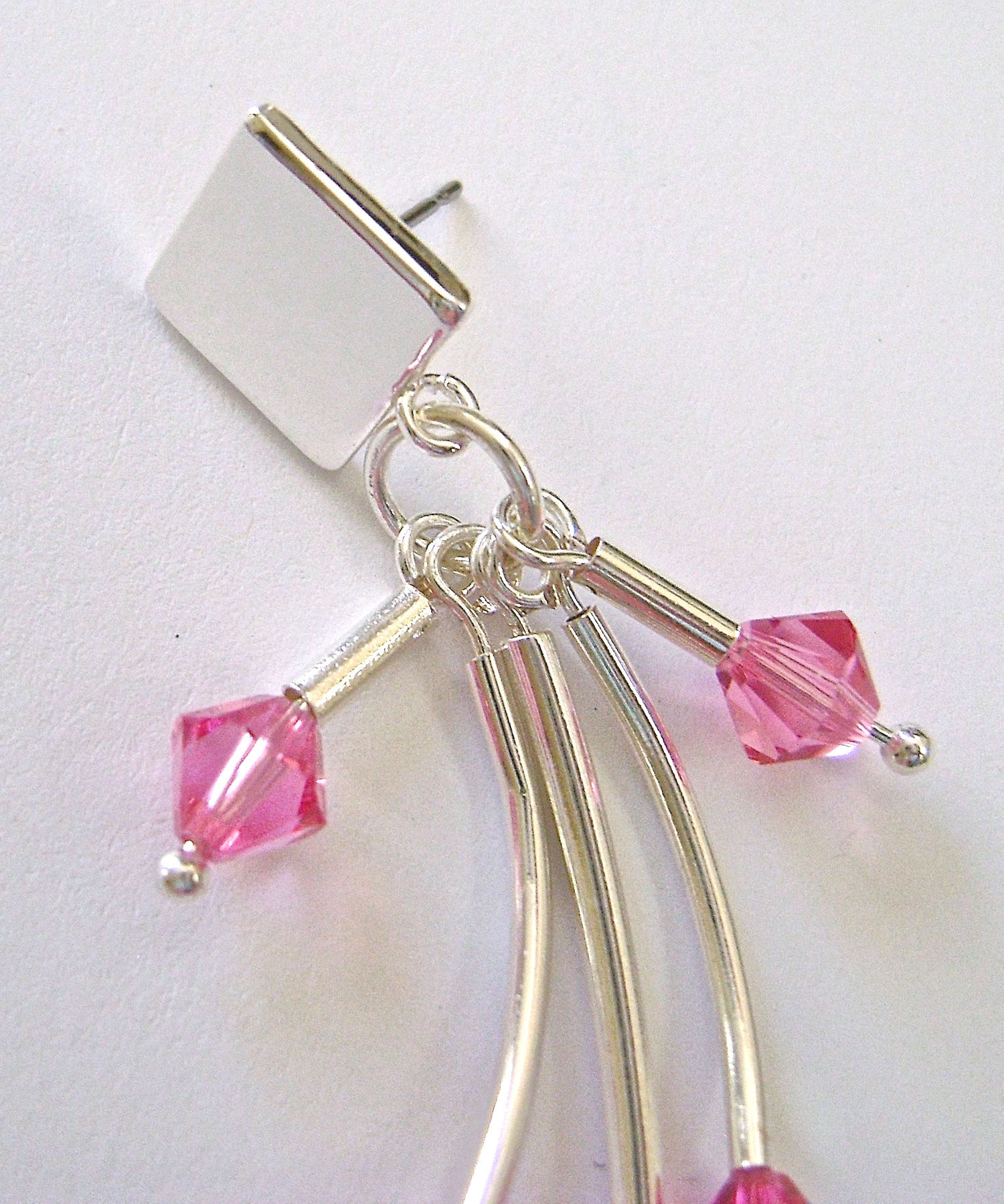 step 7 - Attach the jump ring through the loop in the earring post and close it with pliers.