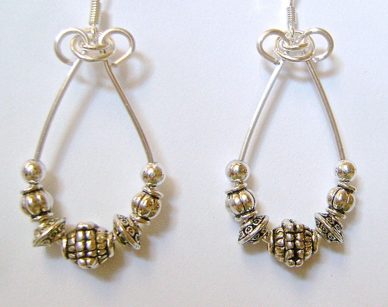 "earrings measure 1.50"" long"