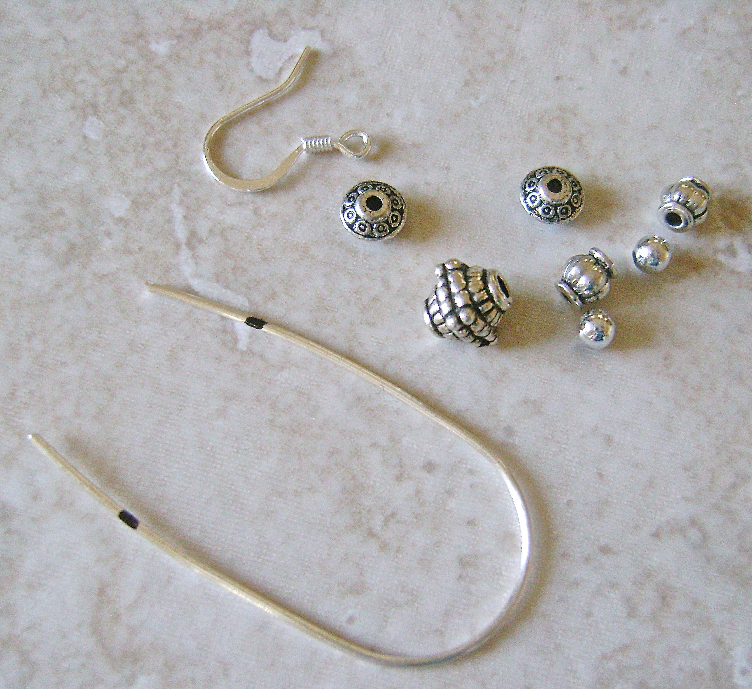 "step 1 - Cut a piece of wire to measure 4.50"" long.  The above photo shows the materials you'll need for each earring.  My largest bead measures 8mm and the smallest is 3mm."