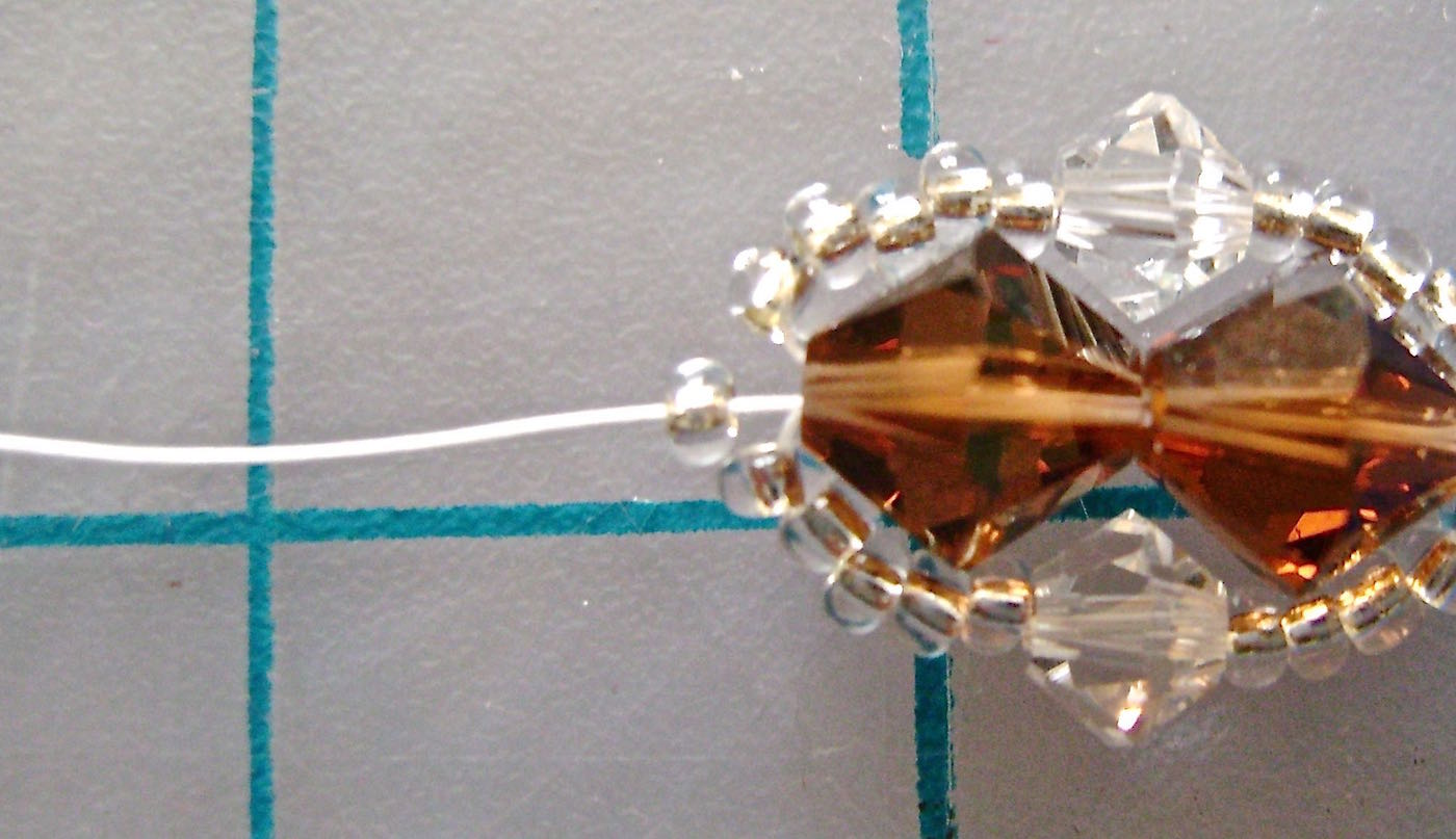 step 8 - To finish this side of the bracelet, string on one more seed bead.
