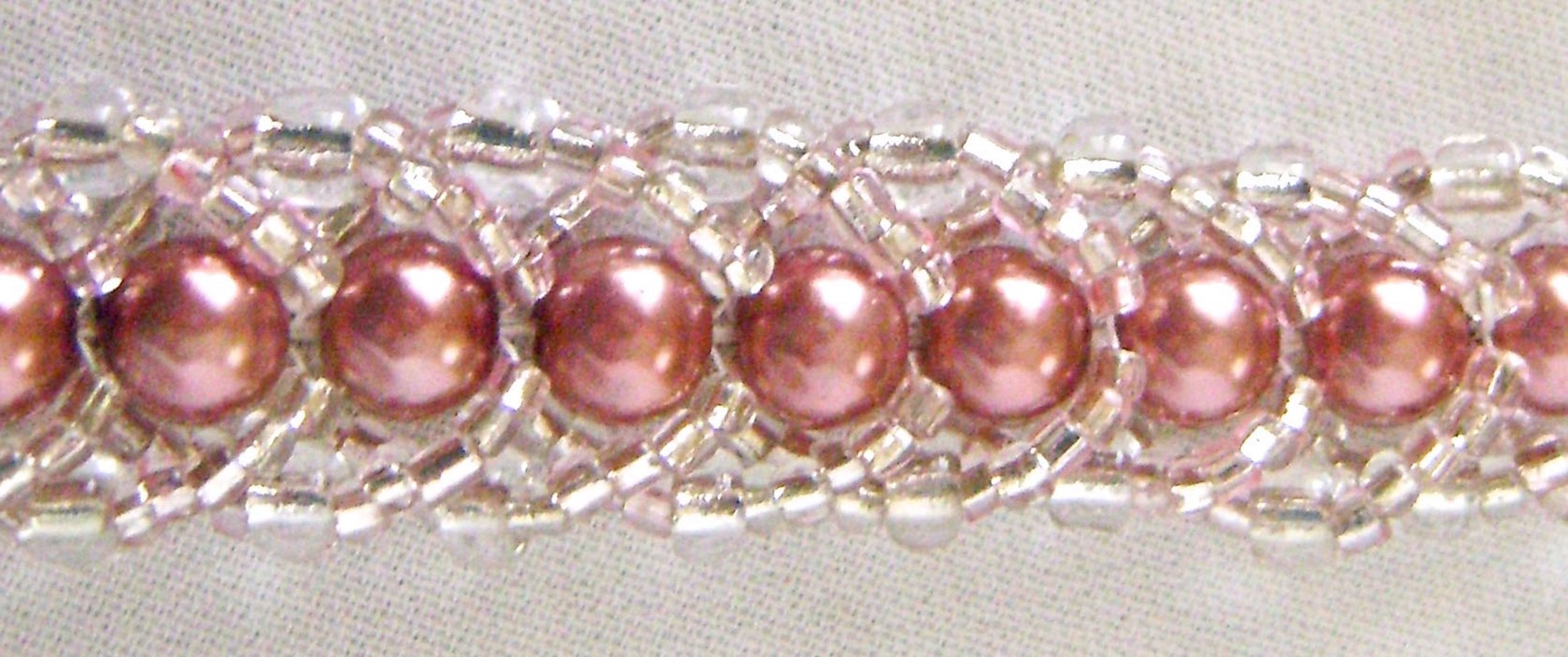 Pearls in 6mm dusty rose, 4mm clear crystals, clear and pink seed beads