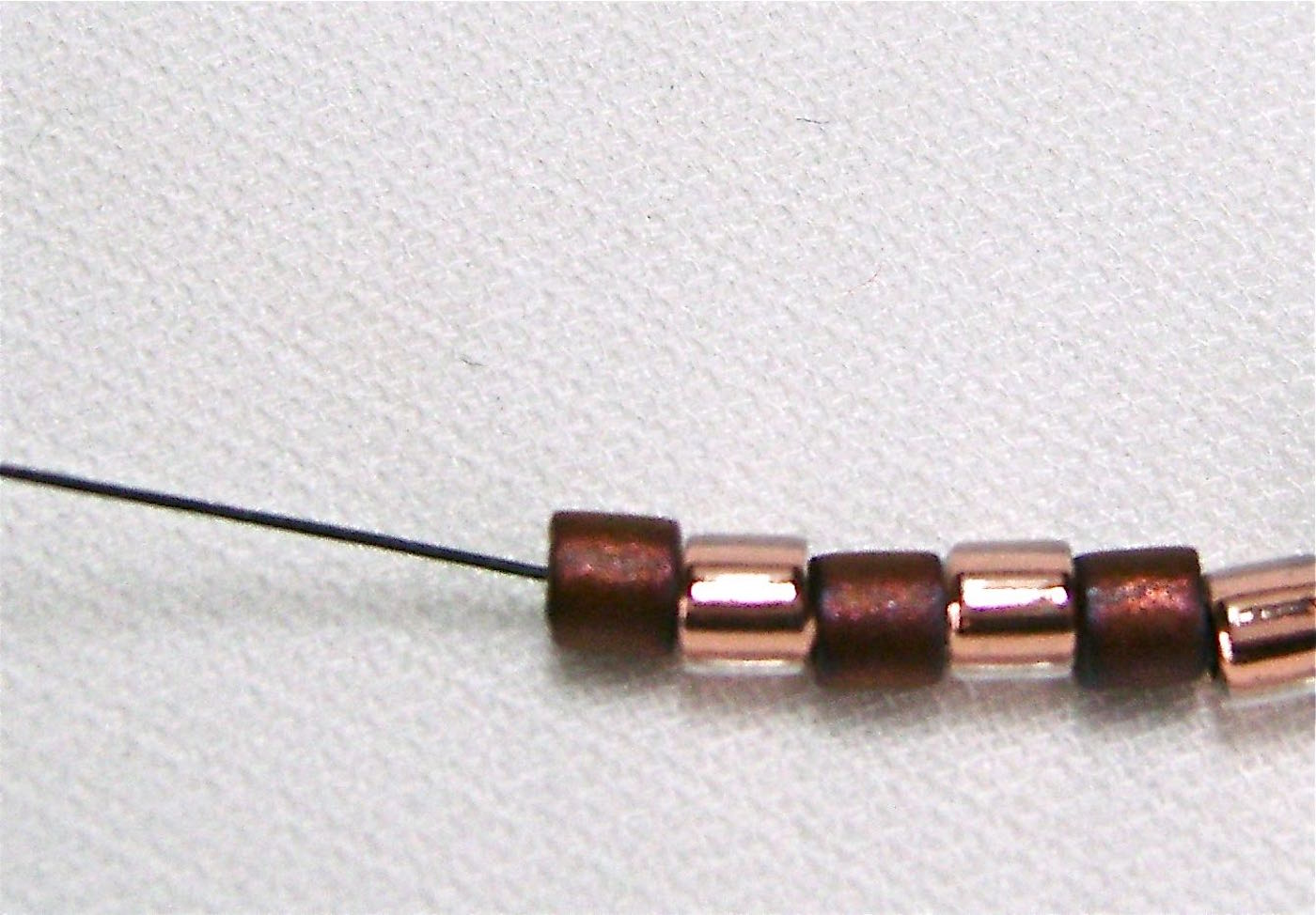 step 2 - String on six seed beads.