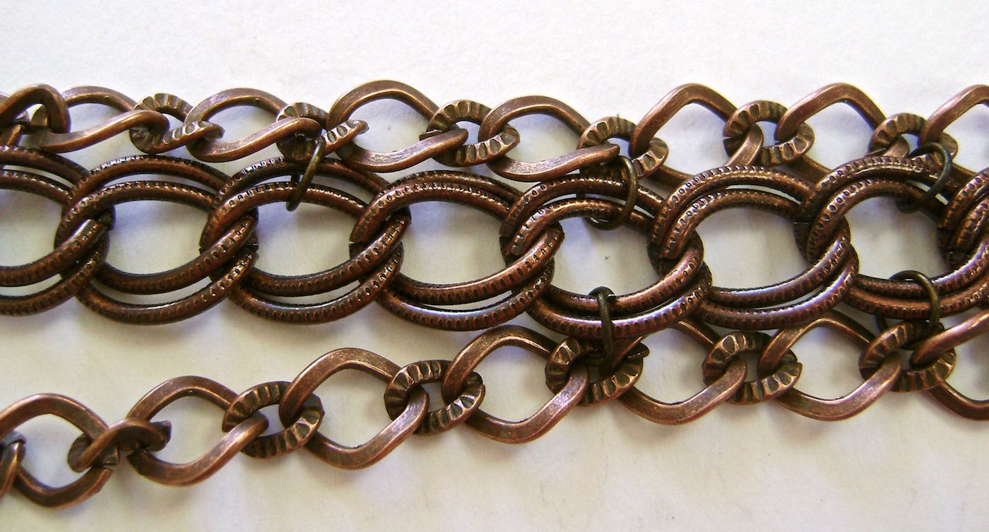 step 1 - The smaller chains come ready to wear as bracelets or necklaces. Remove all links, jump rings and clasps on the ends. To help with the link alignment, connect a few of the middle links to the double link of the larger chain with purchased jump rings.