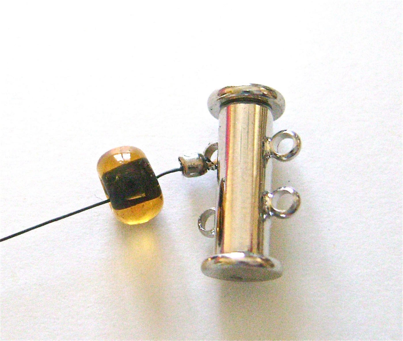step 2 - Attach a 6mm round bead with a hole large enough to slip over the crimp bead.