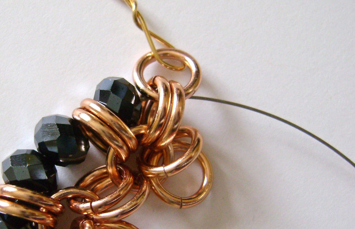 step 4 - Add two beads and pass through the next two rings.