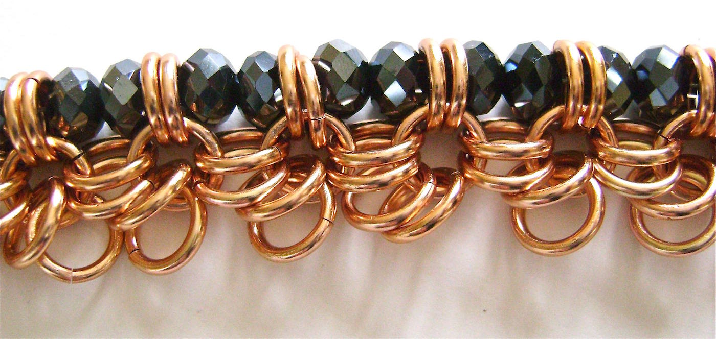 step 5 - Continue Adding two beads and passing the wire through the double rings until you reach the end of the bracelet.