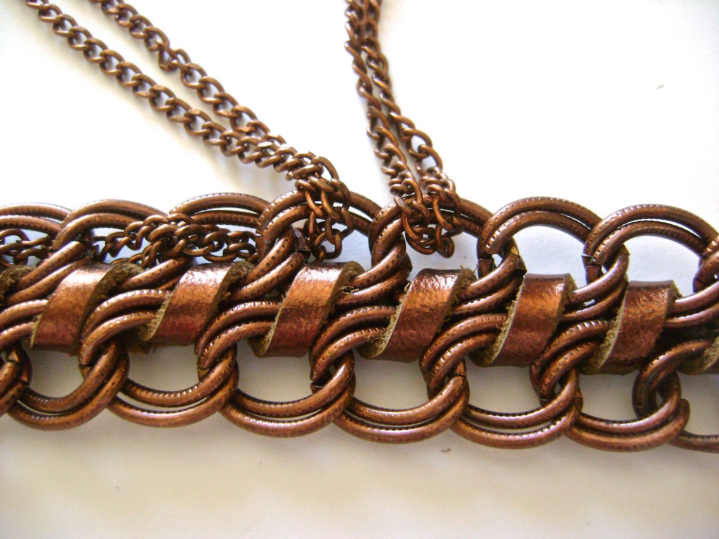 "step 6 - Cut the thin chain to measure 30"".  Fold it in half and weave the folded end into the large links on one side of the bracelet."