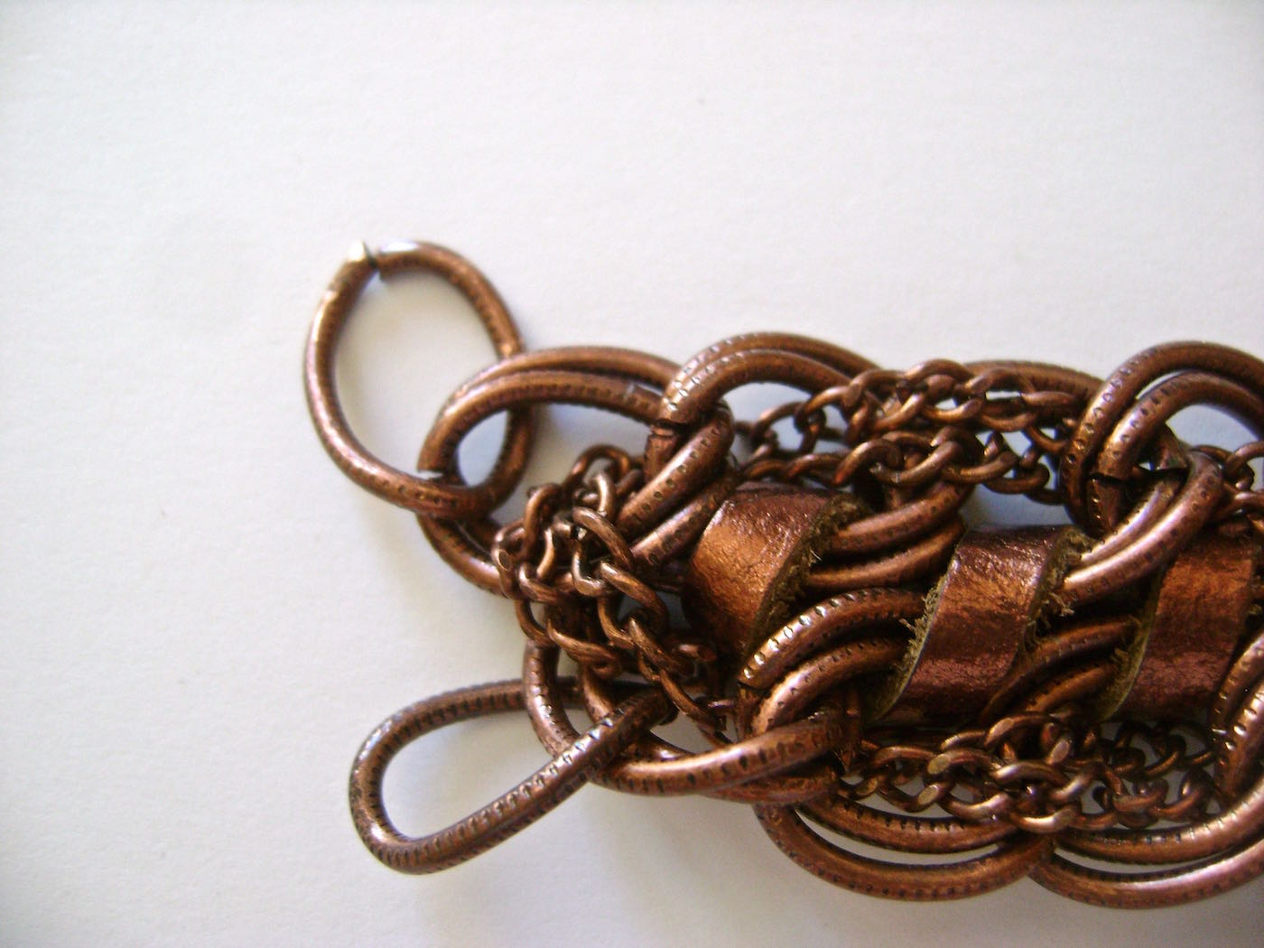 step 9 - Repeat with the remaining two chain ends. Remove the excess chain. The connected chains should not be so tight that it prevents the bracelet from laying flat. Replace the links you removed in step five.