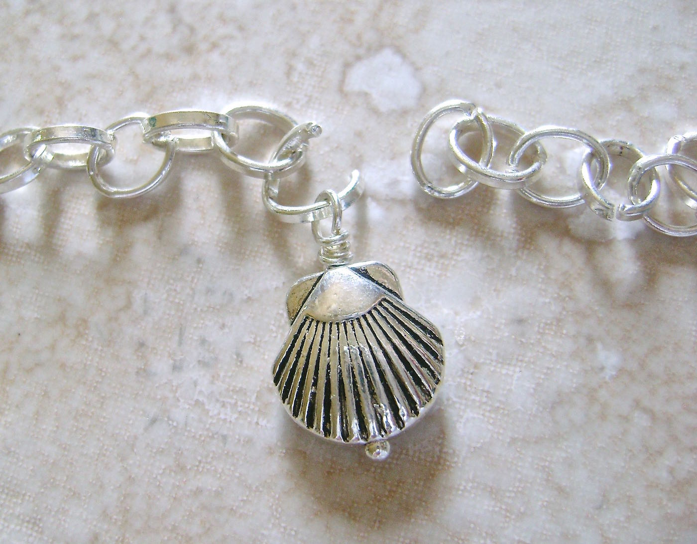 step 6 - Create 13 loop wrapped shells. Open the center link of the chain and attach a shell loop.