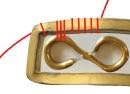 step 2 - Curl the other end of the wire in the opposite direction to form a figure eight.  Do the same with all ten wires.