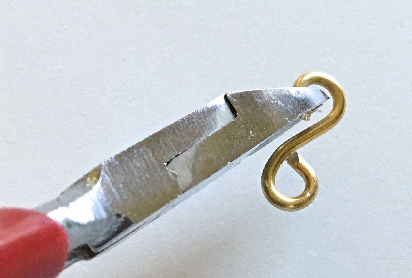 "step 8 - Continue working toward the center back of the bracelet on one side. As you move toward the spring hinge, the frame becomes more narrow.  Adjust the size of the last three figure eights by clipping off 1/4"" from each raw end."