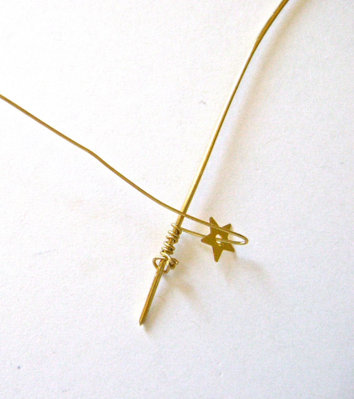 """step 5 - Cut a piece of 18 gauge wire to 6"""" long. I'll call this the core wire. Cut a piece of 26 gauge wire to 24"""" long. Wrap the thinner wire around the core wire seven times. Make a bend in the wire at about 3/8"""" from the core wire. Slide a star into the bend."""